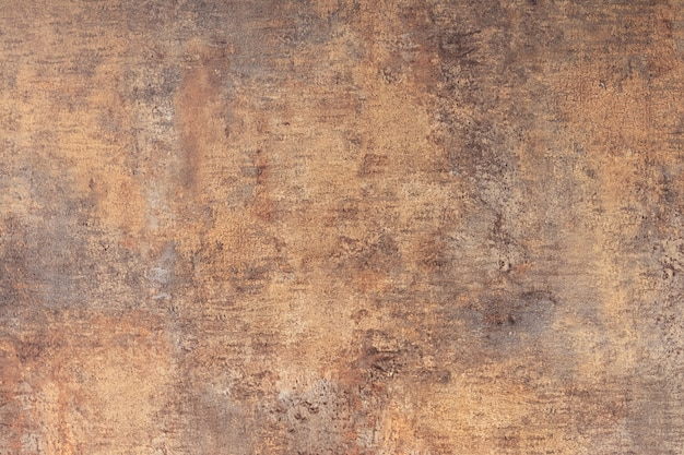 The texture of the concrete wall is covered with brown coating and cracks background