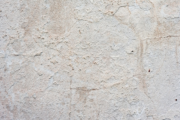 Texture of a concrete wall with cracks and scratches
