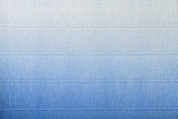 Texture of corrugated blue and white paper with gradient