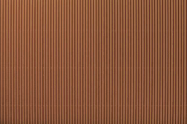 Texture of corrugated dark brown paper, background.