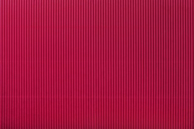 Texture of corrugated dark red paper, macro.