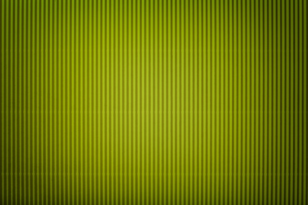 Texture of corrugated green paper with vignette, macro.