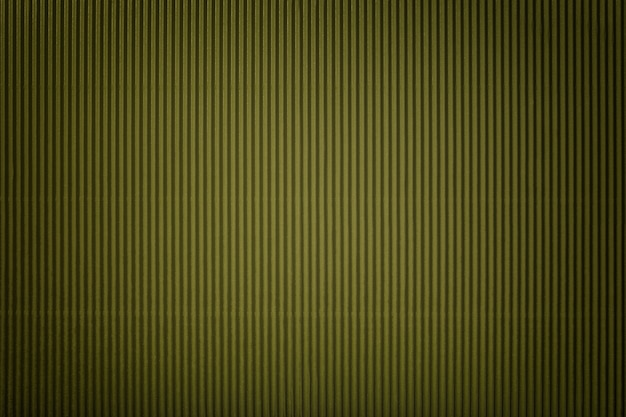 Texture of corrugated green paper with vignette