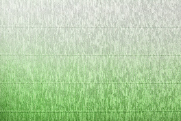 Texture of corrugated green and white paper with gradient
