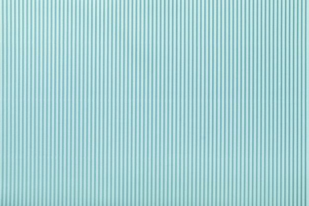 Texture of corrugated light blue paper, macro.
