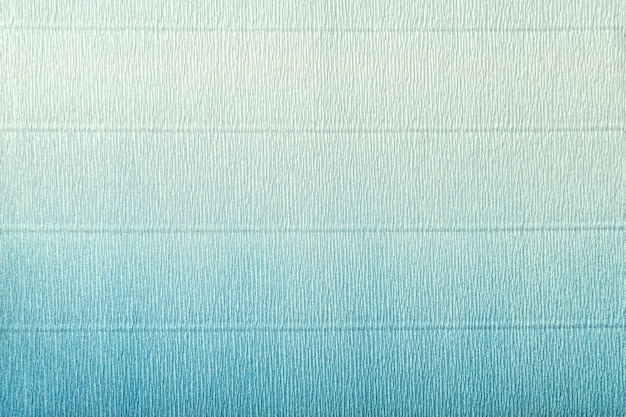 Texture of corrugated light blue and turquoise paper with gradient
