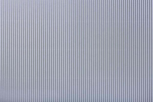 Texture of corrugated light gray paper, macro