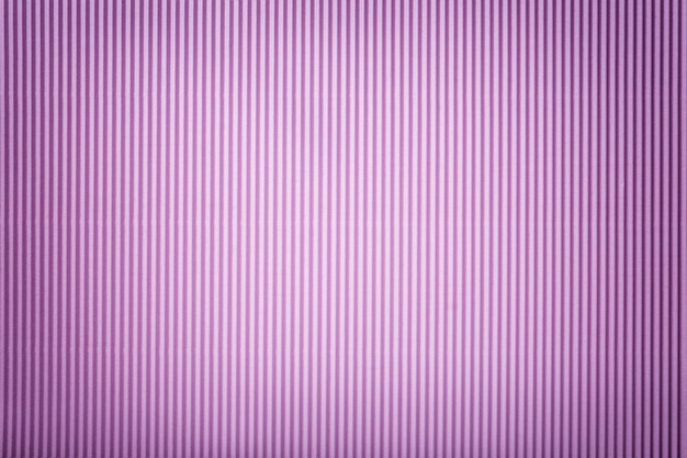 Texture of corrugated lilac paper with vignette