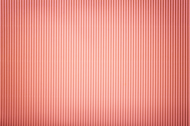 Texture of corrugated pink paper with vignette,