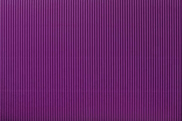Texture of corrugated purple paper, macro. striped pattern