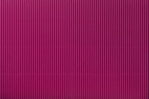 Texture of corrugated purple paper, macro. striped pattern