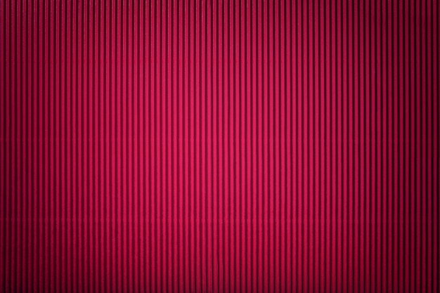 Texture of corrugated red paper with vignette