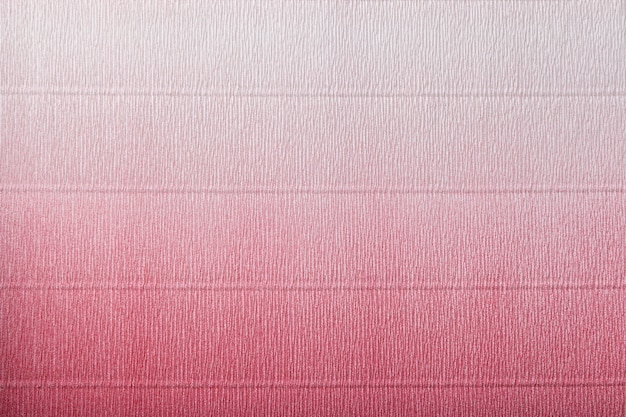 Texture of corrugated red and white paper with gradient