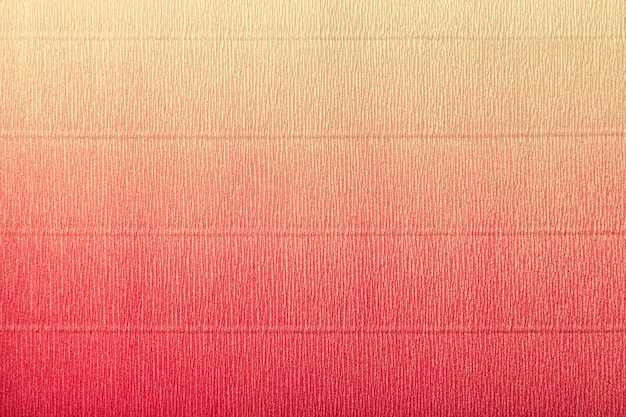 Texture of corrugated red and yellow paper with gradient