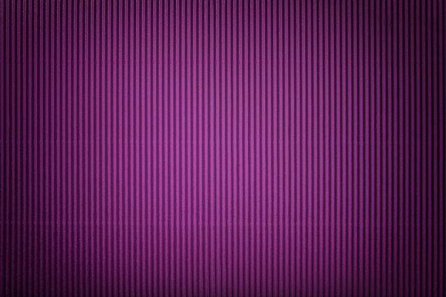 Texture of corrugated violet paper with vignette
