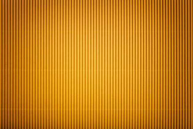 Texture of corrugated yellow paper with vignette
