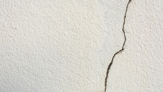 Texture of crack white cement wall - background