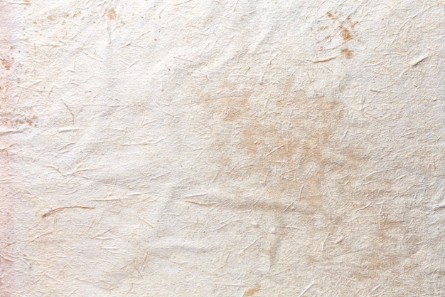 Texture of craft beige old paper, crumpled background. vintage white  surface.