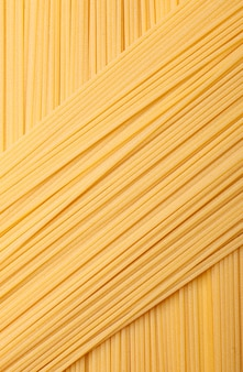 Texture of crossed pasta spaghetti, macro photography