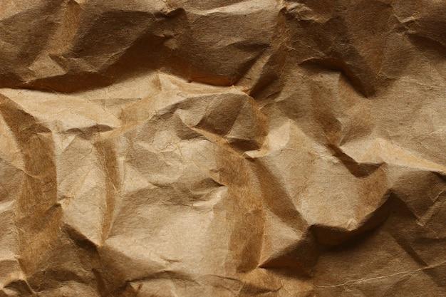 Texture crumpled brown paper closeup