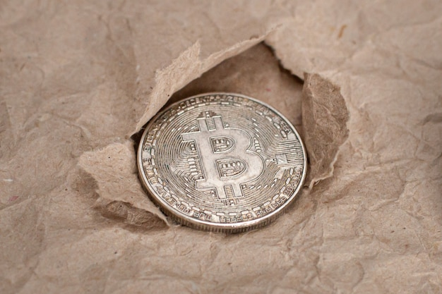 The texture crumpled craft paper and bitcoin