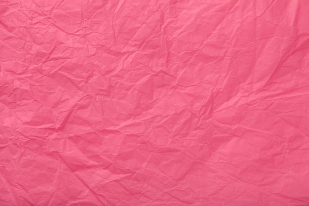 Texture of crumpled pink wrapping paper
