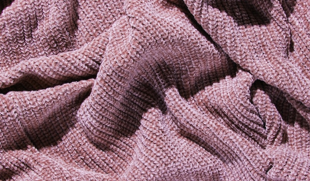 Texture of crumpled purple knitted