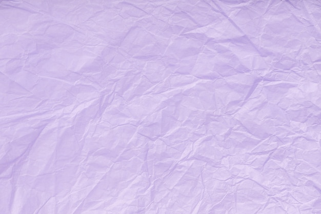 Texture of crumpled violet wrapping paper,  lilac old background