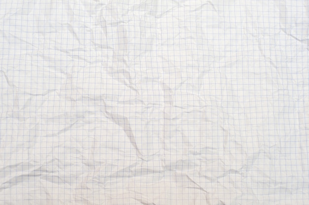 Texture of crumpled white paper in a cage, school notebook