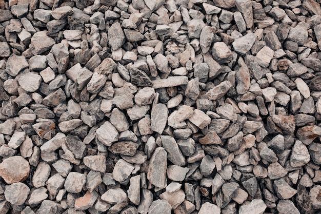 Texture of crushed granite gravel . closeup shot