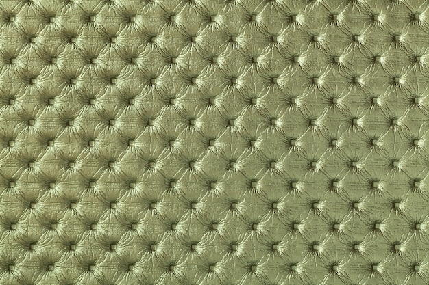 Texture of dark green leather background with capitone pattern