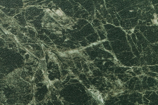 Texture of dark green marble for tabletop with olive lines of a pattern