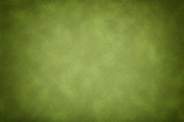 Texture of dark green old paper, crumpled background with vignette