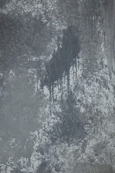 テクスチャダークグレー垂直背景壁漆喰