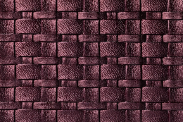Texture of dark purple leather background with wicker pattern