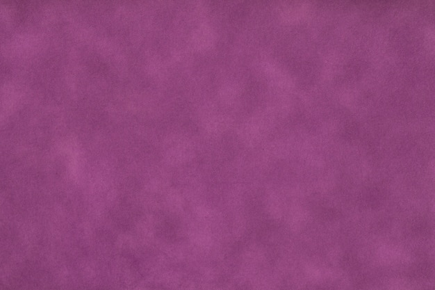 Texture of dark purple old paper, crumpled background. vintage lilac grunge surface backdrop. structure of craft parchment cardboard.