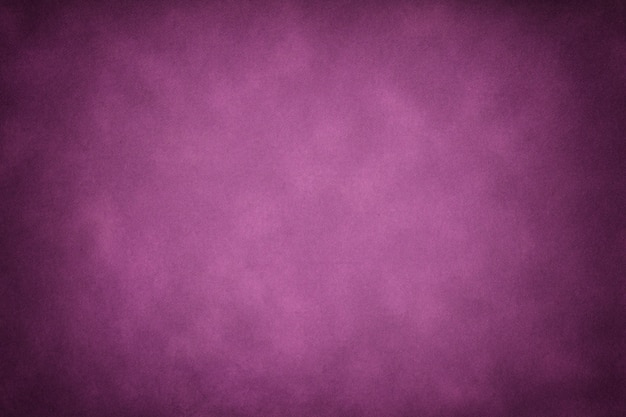 Texture of dark purple old paper, crumpled background with vignette