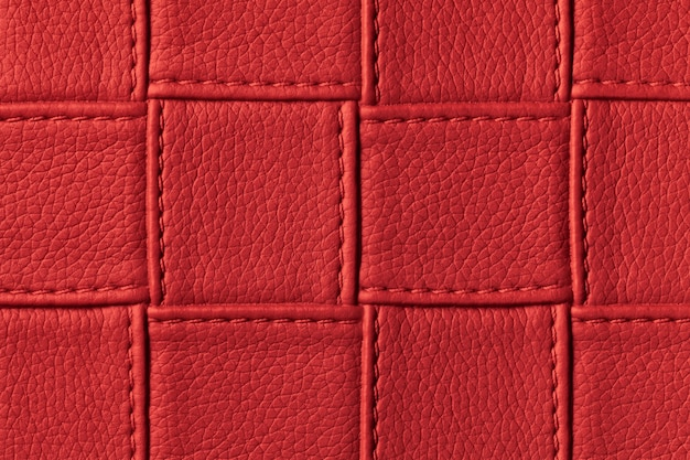 Texture of dark red leather background with square pattern and stitch.
