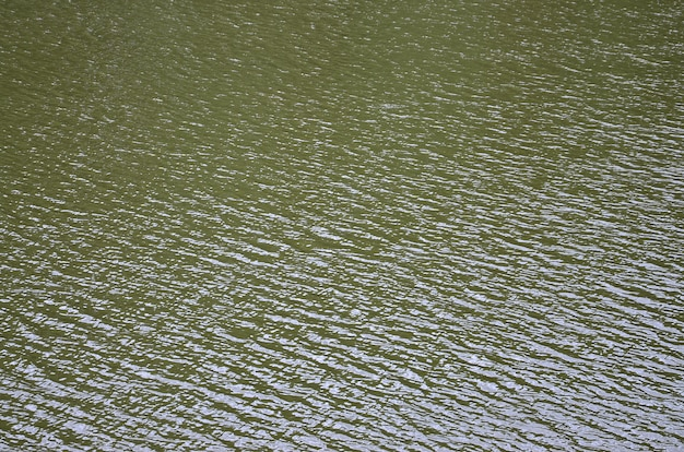 The texture of dark river water under the influence of wind