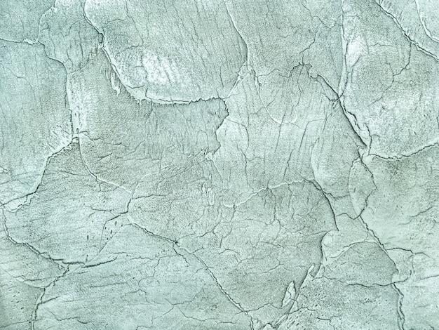 Texture decorative green plaster imitating the old peeling wall