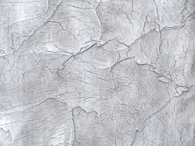 Texture decorative silver plaster imitating the old peeling wall.