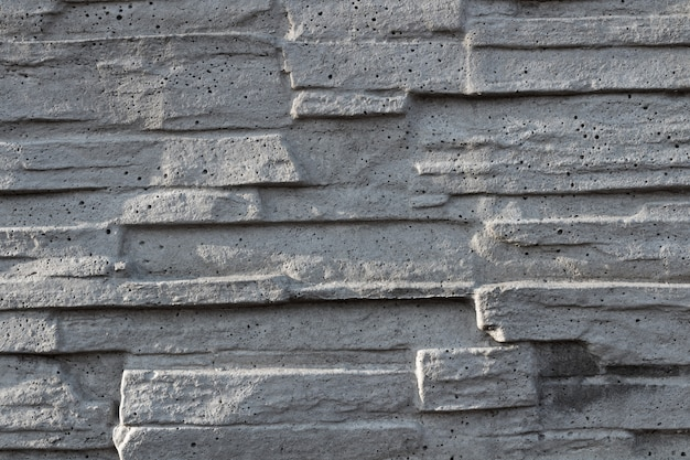 Texture of decorative white slate stone wall surface