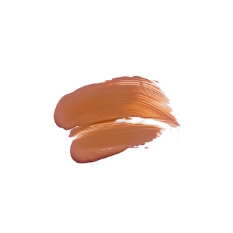 Texture of deep brown liquid foundation.liquid foundation smudges isolated