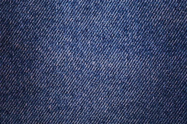 Texture denim. cloth rough, worn, with small defects, slight darkening at the corners.