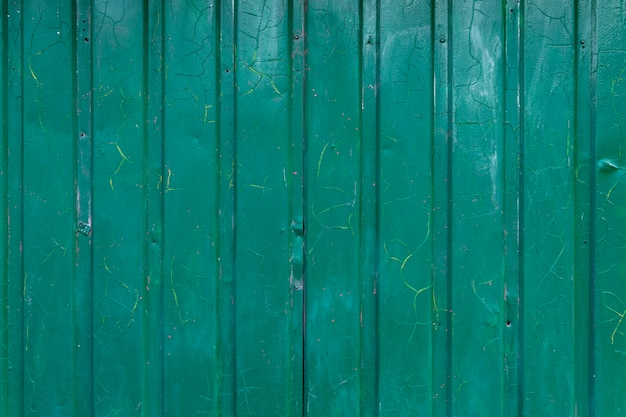 Texture of dirty blue-green iron fence. iron sheet. background. space for text.