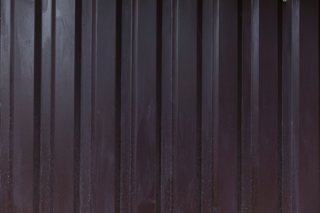Texture of dirty dark brown iron fence. iron sheet. background. space for text.