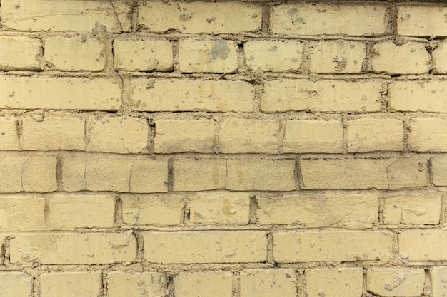 Texture of a dirty yellow brick wall. background. space for text.