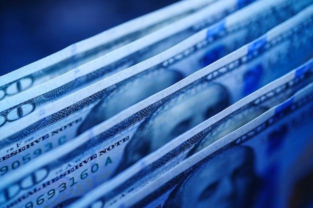Texture of dollar bills in blue tones