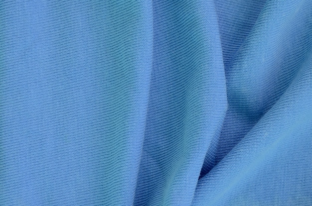The texture of the fabric in blue background