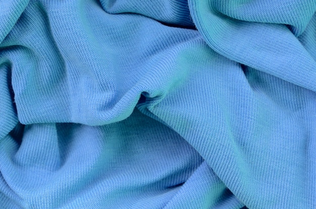 The texture of the fabric in blue color. material for making shirts and blouses
